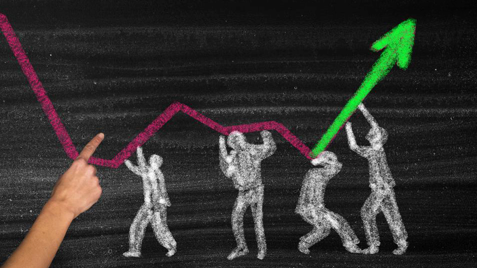 Chalkboard drawing of people holding up a graph