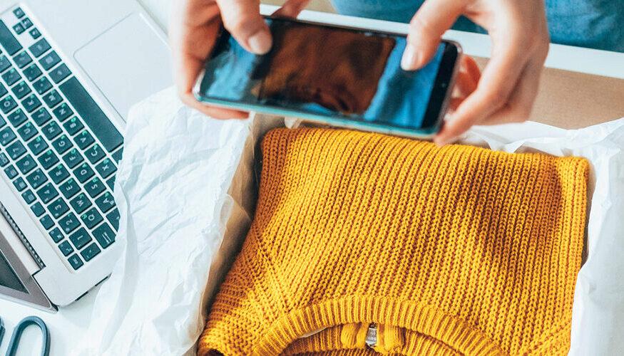 Woman taking photo of yellow sweater