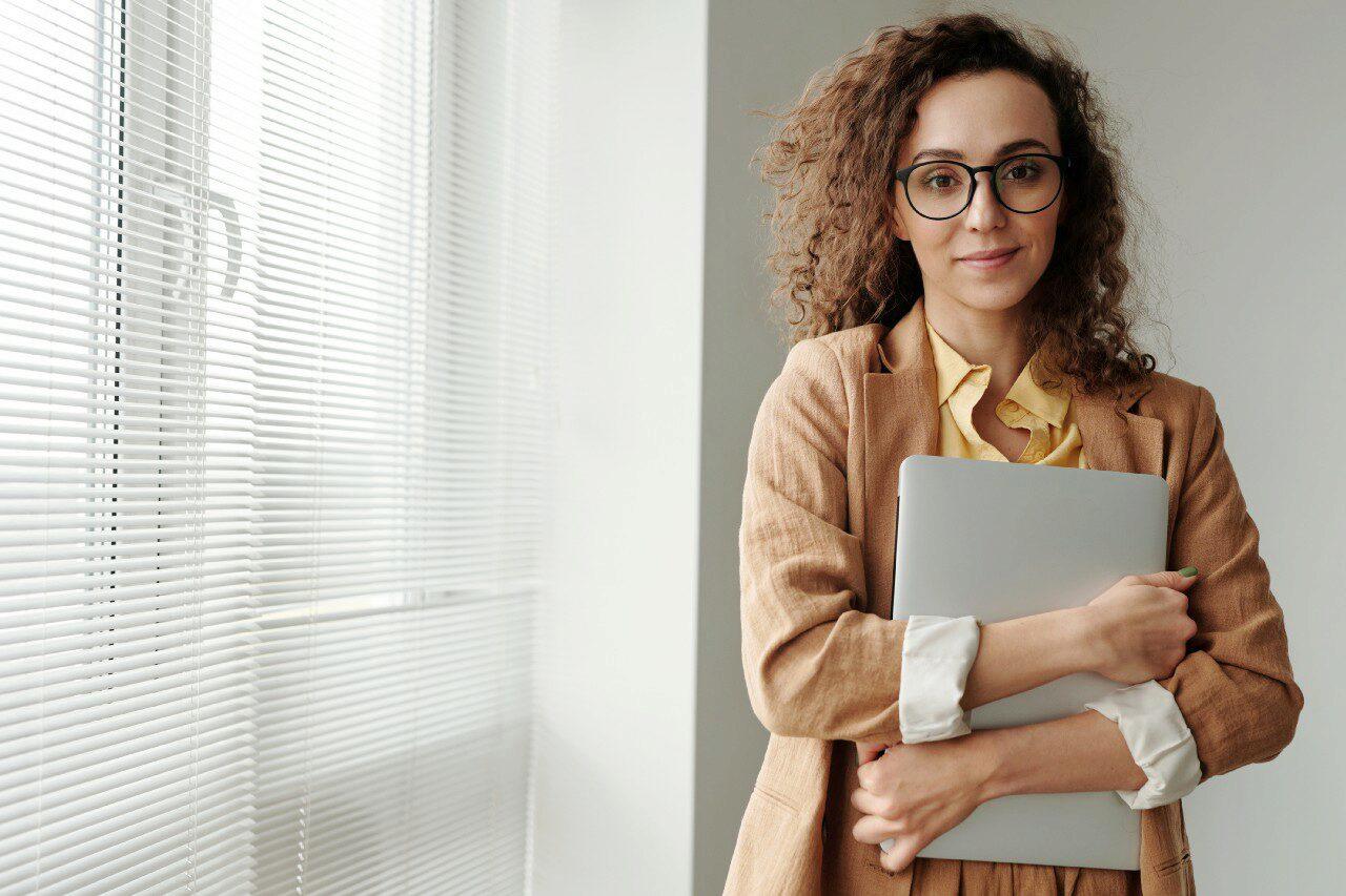 women holding a laptop